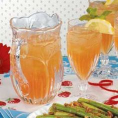 Minted Iced Tea Cooler 3 peppermint-flavored tea bags 7 cups boiling water 1 cup cranberry juice 3/4 cup thawed pink lemonade concentrate