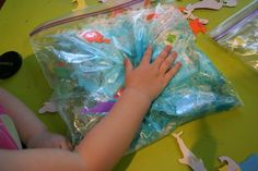 an ocean themed sensory bag with various ocean items. Several other ocean themed activities at the bottom of the post