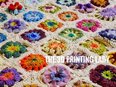 Crochet Flower Blanket using a mix of new and recycled yarns reclaimed from old jumpers.  Individual motives had been stitched together to form fabrics of approximately 1 x 1.5m.   Part of the local up-cycling #yarnbombing project.  Original project completed in March 2010.  © HD Grzywnowicz, 2019  #flower #motif #crochetsquare #babyblanket #blanket #afghan #szydełko #colour #crochet #aiguille #編み物 #yarnart #3dfabric #hybridfabrics  #3dprintinglady #3dpl