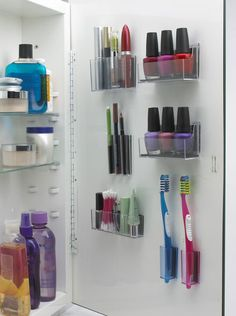 Dang, this is smart: storing toothbrushes & makeup on a vertical surface instead of on the counter.