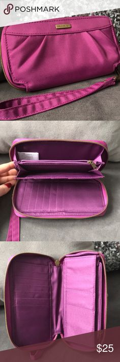 Travelon | fuschia pink RFID wallet ▪️orchid color Travelon ZIPPERED wallet.  ▪️RFID-protected, pleated front detail, detachable strap, antiqued brasstone hardware, zip-around closure ▪️Lined interior, 10 card slots, two bill pockets, zippered coin compartment ▪️Fits most smartphones, including the iPhone 6+ ▪️Measures approximately 7-1/2″W x 4″H x 1″D with a 6″ strap ▪️Shell/lining 100% polyester ▪️Wipe clean with a damp cloth ▪️Imported  Can be used as wristlet. Hold credit cards. Cash…