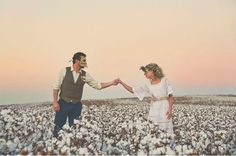 Masquerade engagement photos in a cotton field