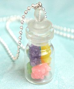 this necklace features a miniature jar of handmade gummy bears made from liquid polymer clay. the glass jar measures about 2.5 cm tall and is securely attached to a silver tone ball chain necklace tha