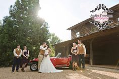 Bridal party portrait with vintage red car. Country fall wedding at hunting lodge.  Photography:  Andie Freeman Photography www.TheAthensWeddingPhotographer.com Coordinating, floral, and event design:  Wild Flower Event Services Venue:  Fair Weather Farms, Monroe, GA Catering:  Master's Table www.cateringbythemasterstable.com