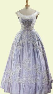 Pale blue silk faille evening gown worn by Queen Elizabeth II, designed by Norman Hartnell, English, 1961. In early 1961 The Queen embarked upon a six-week tour of India and Pakistan. The Queen and The Duke of Edinburgh attended a dinner given by the Commander-in-Chief of the Pakistan Army, for which Her Majesty wore a magnificent crinoline gown of pale blue silk faille, embroidered all over with white beads in a feather motif.