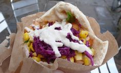 Falafel queen: pita bread with salads, tabouli, corn, hummus, tahini, warm chickpeas, and chili sauce.