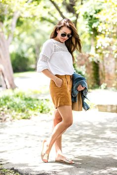 White blouse + mustard yellow shorts + jean jacket + gold slip-on sandals
