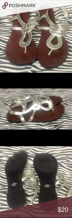 NWOT Sliver 7.5 Kelly & Katie Thong Toe Sandals New never worn, been in storage. Sliver with a buckle strap on ankle. Kelly & Katie Shoes Sandals