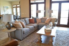 We added colorful throw pillows to this gray Taylor King Sectional.  The shag rug updates the space and is comfortable for the kids to sprawl out on.