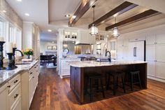 Hickory Floors, white cabinets, dark island