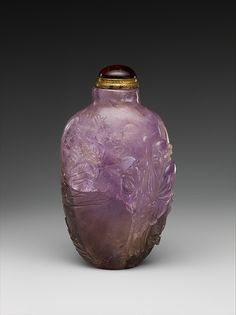 Snuff bottle with figure in a garden   Period: Qing dynasty (1644–1911)  Date: 19th century  Culture: China  Medium: Amethyst