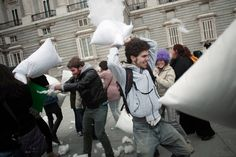 """(REUTERS/Susana Vera) Revelers take part in a pillow fight outside Madrid's Royal Palace February 14, 2011. The pillow fight was a flash mob event organised by """"MadridMobs"""" with the only rules being to have fun and clean up after yourself. By the way, if you want to invite someone to a """"pillow fight"""" in Madrid, the phrase is """"guerra de almohadas."""""""