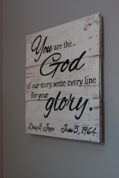"""""""The God of our Story"""" sign with customized names/date measures approximately 16""""X16"""" and in distressed white w/ black text is $55. *Use the promo code """"FREEATLANTAPICKUP"""" if you live in the ATL area and will be picking up your order personally. Message me for address.*"""