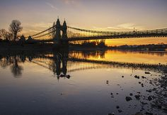 © All rights reserved.  The sunsets behind Hammersmith bridge to the west of central London. The still River Thames reflects the colours and scenery perfectly as it is scene from the foreshore at low tide.  Please don't place links to your own images . wqawa thnx for sharing here u can sind discount london pass : visitarlondon.blogspot.com