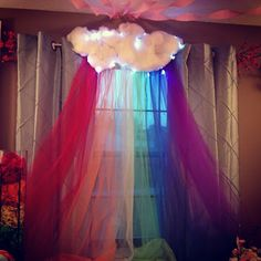 Cloud with Rainbow Tulle decoration for behind the party table. Genius!