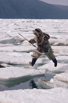 Inuit hunter, Kavavow Kiguktak, jumps from one ice floe to another. Ellesmere Is. Inuit Kunst, Arte Inuit, Inuit Art, Alaska, Inuit People, Water Tribe, O Canada, Inuit Canada, Brother Bear
