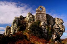One of the most interesting and distinctive landmarks of mid-Cornwall, this is the granite outcrop of Roche Rock and the ruins of the chapel perched at the top.              Cornwall