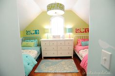 kids beds - reminds me of Mary Poppins nursery!