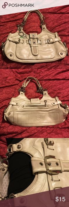 Kathy van Zeeland handbag Kathy van Zeeland bone leather purse. Chain link handles with many pockets, front pocket, inner middle zipper pocket and 3 small pockets. Some wear on edging, see 3rd picture. Still in great condition. Kathy Van Zeeland Bags Shoulder Bags