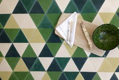 Half Karat Tile in Multi Green by Marrakech-based Popham Designs. Caitlin and Samuel Dowe-Sandes, the American founders, work with Moroccan mellums, or tile artisans, who produce the concrete tiles in an energy-efficient hydraulic press. Available at Ann Sacks.