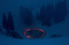 Burning brightly amidst the snowcapped mountains of the Swiss Alps is Douglas Gordon and Morgane Tschiember's fiery installation As close as you can for as long as it lasts. The temporary piece of blazing land art was produced for the biennial event Elevation 1049, a collection of 11 sculpture, perf