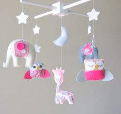 Elephant Mobile: You get to pick the colors that make this cute and whimsical animal mobile ($99) really special. With cute dots on the giraffe and funky patterned fabric for the sweet owl, this mobile from Etsy seller Love Felt XoXo is fun and unique.
