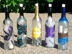 Hand painted wine bottle tiki torches. Such a great idea!