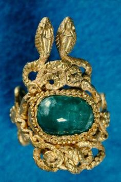 Finger ring with snakes intertwined around an emerald  Greek, Hellenistic Period, 2nd century B.C.