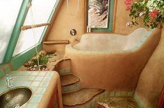 Earthship. NICE!  Small tub like this would be great for kids!