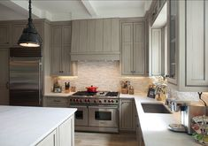Pale Gray Kitchen Cabinets Kitchen Cabinets, while island is white (and side buffet white as well.) Go to website to see farmhouse table Kitchen Hood Design, Kitchen Hoods, Grey Kitchen Cabinets, New Kitchen, Kitchen Dining, Kitchen Board, Kitchen Layout, Kitchen Ideas, Kitchen Island Range