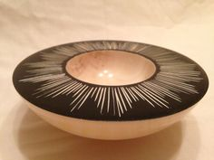 Carved bowl inspired by the work of mark baker