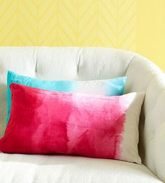 Cute DIY Ombre Pillows - Dip sections of a purchased pillow cover in colorful fabric dye (we used RIT brand) for varying times. For the most intense color, soak for 30 minutes. Leave a portion of the fabric undyed for contrast.