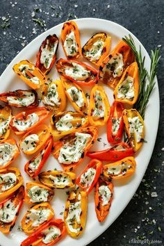 Grilled Mini Sweet Peppers with Goat Cheese - - Grilled Mini Sweet Peppers with Goat Cheese Food & Drink Gegrillte Mini-Paprika mit Ziegenkäse aus afarmgirlsdabbles … Mini Sweet Peppers, Stuffed Sweet Peppers, Recipes With Sweet Peppers, Vegetarian Stuffed Peppers, Mini Paprika, Clean Eating Snacks, Healthy Eating, Clean Eating Dinner Recipes, Healthy Food