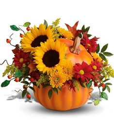 Why not bring the pumpkin patch indoors with a hand-painted ceramic pumpkin filled with a rustic autumn bouquet! Enjoy beautiful seasonal varieties like #sunflowers, daisies, hypericum berries and more.
