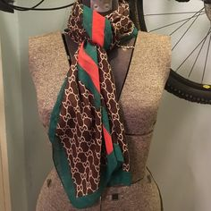 "Rayon scarf.  Designer logos and colors 68"" by 18"". Green, red, brown with designer logos Accessories Scarves & Wraps"