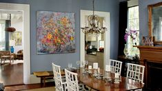 Tell a cohesive color story in connected spaces. The wall color in this dining room was custom mixed to match the blue undertones of curtains in the adjoining living room. See this Classic Charleston Home Dining Room Blue, Dining Room Colors, Dining Rooms, Dining Table, Dining Chairs, Room Chairs, Cane Chairs, Dining Decor, Dining Sets