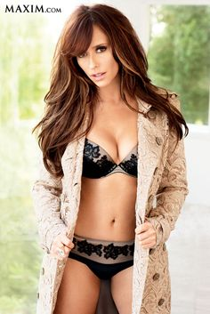 Jennifer Love Hewitt in black and cream lacy underwear and cream color jacket posing in a yard.