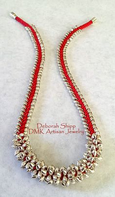 This Kumihimo Necklace has been designed by Deborah Shipp and it is part of her DMK Designer Collection. The necklace has been made with Red