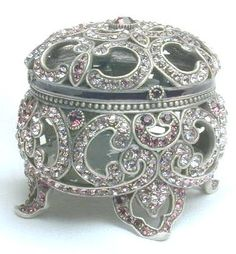 Buying something stunning like this and putting a ring or another piece of jewelry inside it would be just the perfect gift...