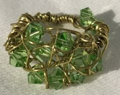 Etsy の Gold crystal wire wrapped ring by Chival