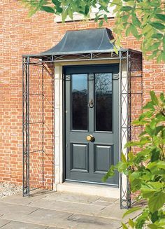 Find this Pin and more on Awnings. & Image result for door canopy ireland | porch ideas | Pinterest ...