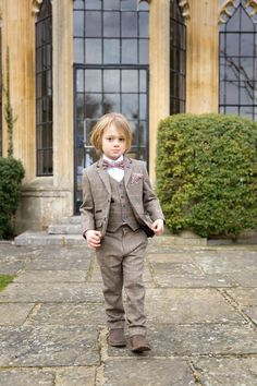 How to get the most out of your wedding day; a wedding shoot in Surrey | Tweed page boy outfit with floral accents from Hire 5 | bridemagazine.co.uk