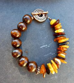 Genuine Baltic Amber, wood and copper metal bracelet. Amber jewelry.