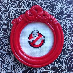 Ghostbusters logo completed cross stitch in a small frame.    ❥Everyone loves the classic movie Ghostbusters, display this cross stitch for