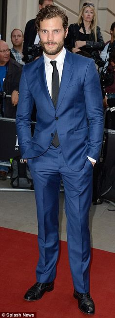 Fifty shades of blue: Jamie Dornan and Luke Evans forego traditional black for their dapper outfits
