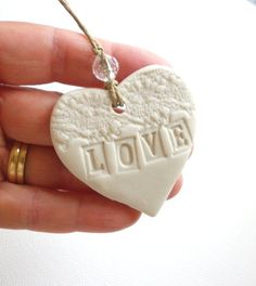 Love Hearts, A set of 20  Made to order personalised porcelain hearts for wedding favours. £140.00, via Etsy.