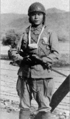 japanese navy paratrooper armed with a type 99 arisaka rifle (dutch east indies, 1942)