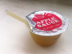 Applesauce cups make a great kids snack on the go. For even more portability, try cutting straws in half and serve them like a juice box instead of using spoons.