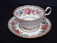 Antique Cup and Saucer Set by Royal Grafton. White base with floral pattern and gold banding