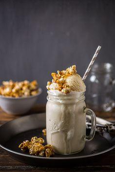 cereal milk milkshake with caramel corn and cornflake clusters